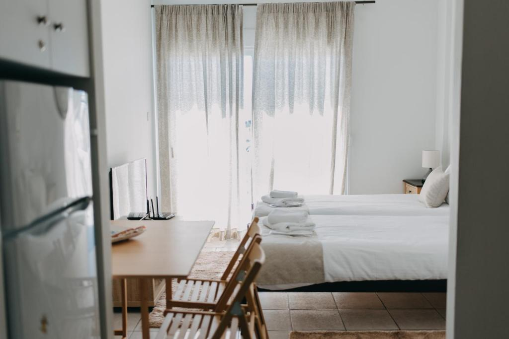 A bed or beds in a room at BEST HOUSE, Town View Appartment, Gounari, Patra