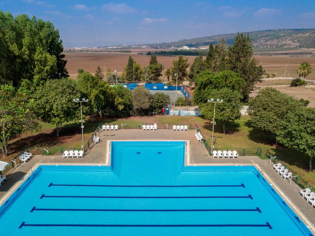 A view of the pool at Holiday Village Kibbutz Mizra or nearby