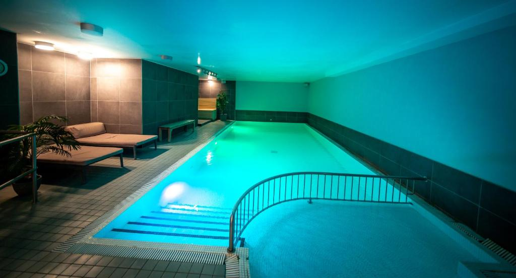 The swimming pool at or near Hotel Saint Sauveur by WP Hotels