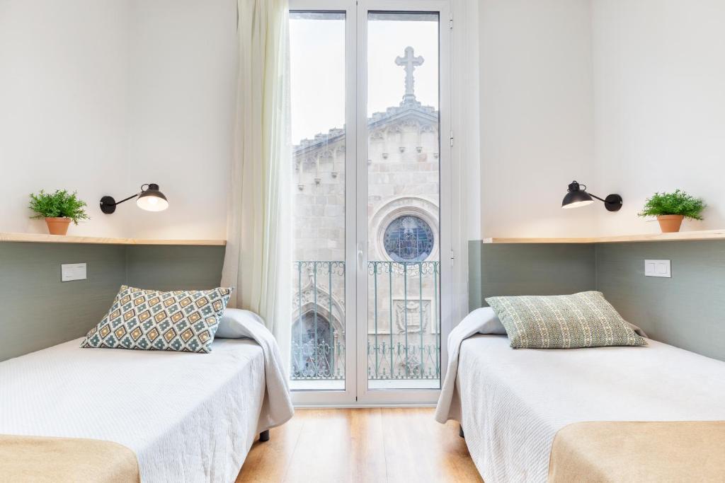 Letto o letti in una camera di Hostal Fernando