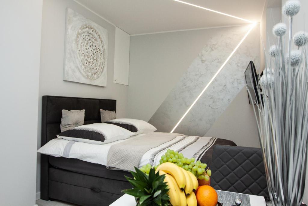 Łóżko lub łóżka w pokoju w obiekcie Novel Mini