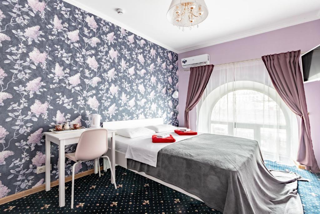 Ein Bett oder Betten in einem Zimmer der Unterkunft Voyage Hotel & Hostel