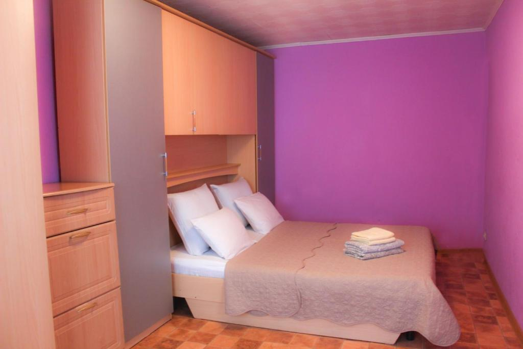 Кровать или кровати в номере Apartment on Leninskiy 45