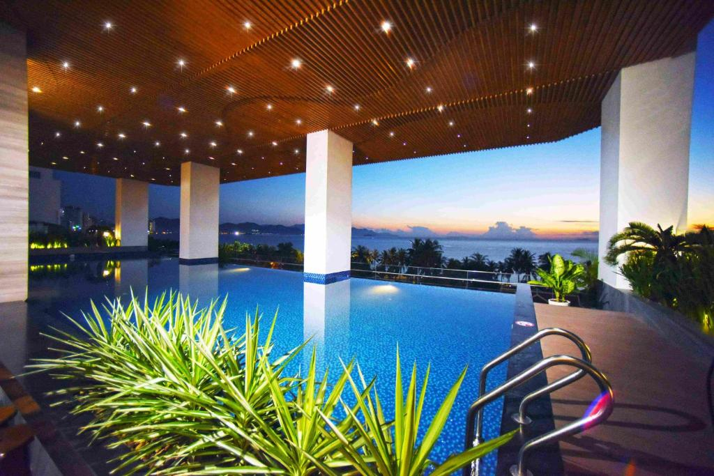 The swimming pool at or close to Queen Ann Nha Trang Hotel