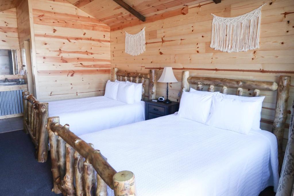 Un ou plusieurs lits dans un hébergement de l'établissement Bryce Valley Lodging
