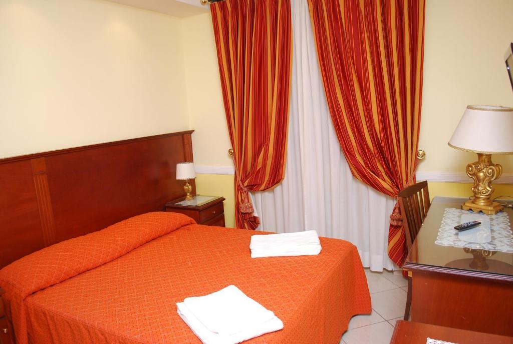 Кровать или кровати в номере Hotel Valentino Palace