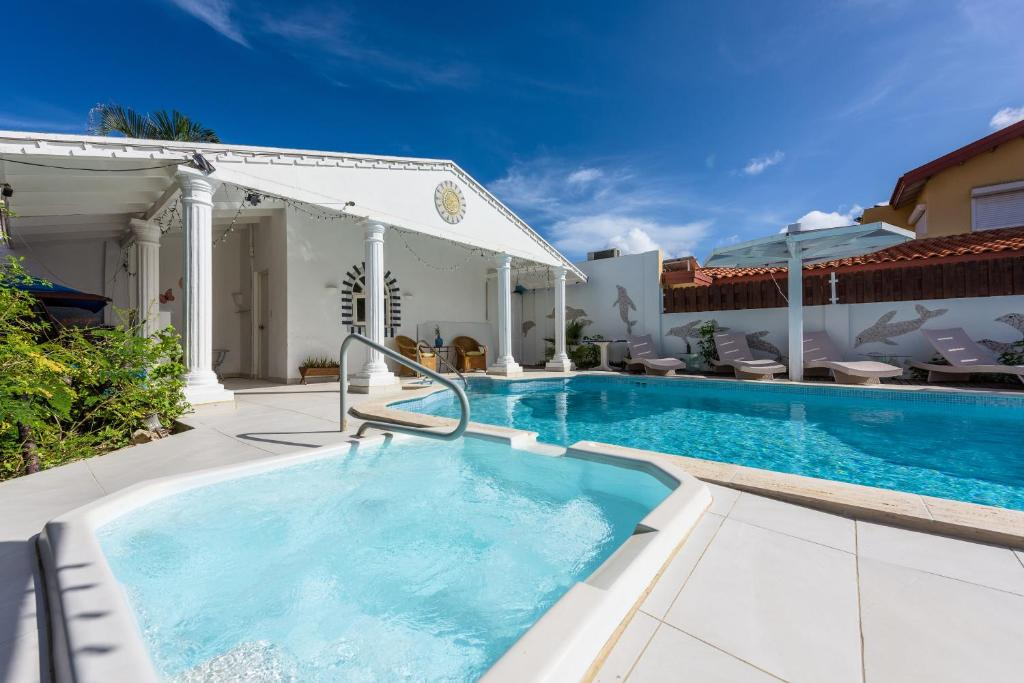 The swimming pool at or near Sunflower Villa Studios