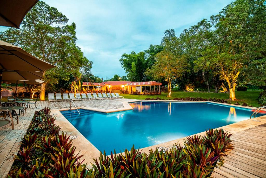 The swimming pool at or near Hotel Chichen Itza