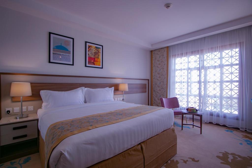 Cama ou camas em um quarto em Le Bosphorus Hotel - WS