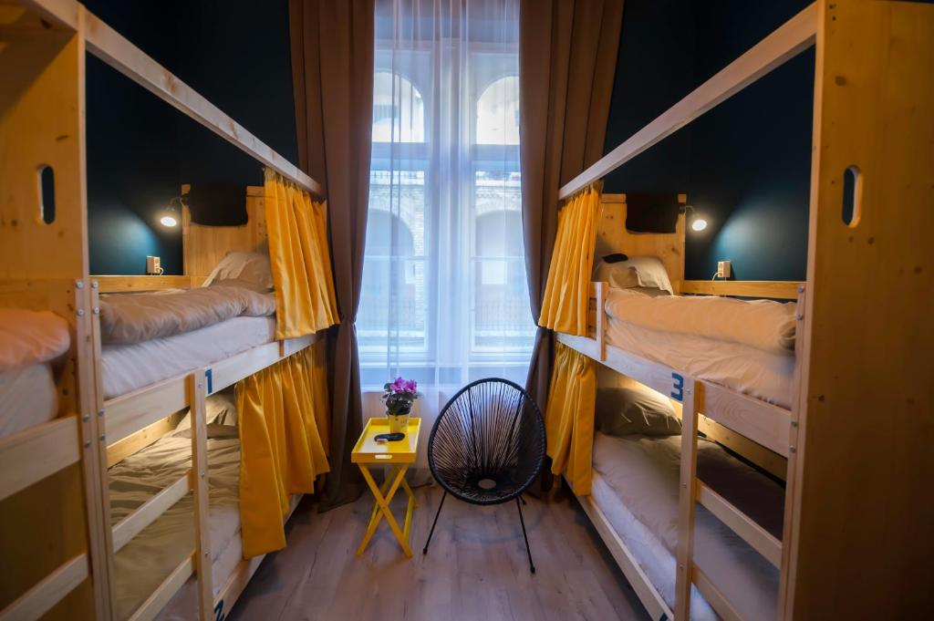A bunk bed or bunk beds in a room at InVerve Hostel