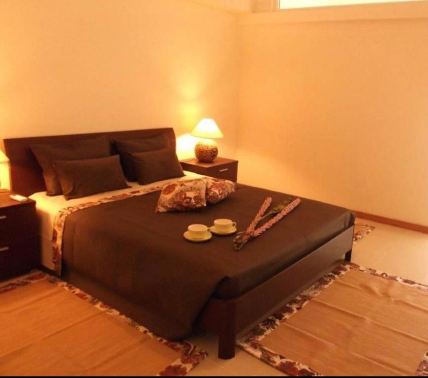 A bed or beds in a room at Villa contemporaine