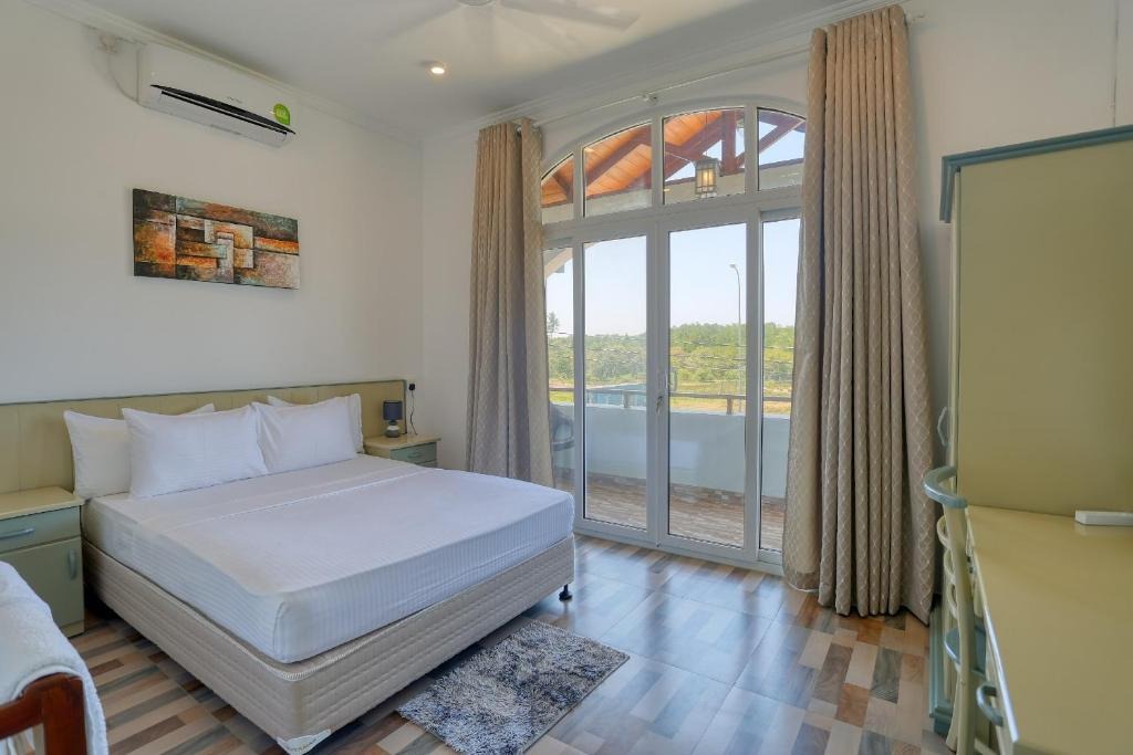 A bed or beds in a room at Shamaz Galle - Level 1 Certified