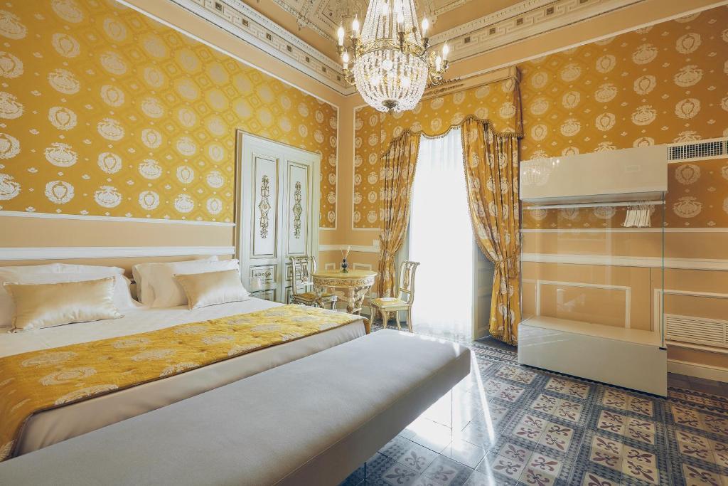 Letto o letti in una camera di Palazzo Marletta Luxury House Hotel