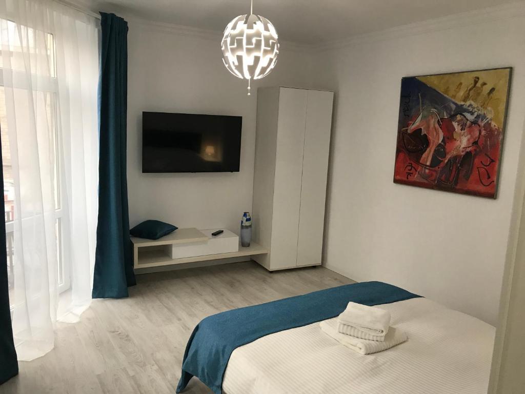 Un pat sau paturi într-o cameră la Tomis 105