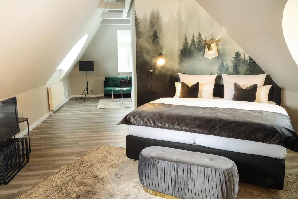 Ein Bett oder Betten in einem Zimmer der Unterkunft Meinsbur Boutique Hotel