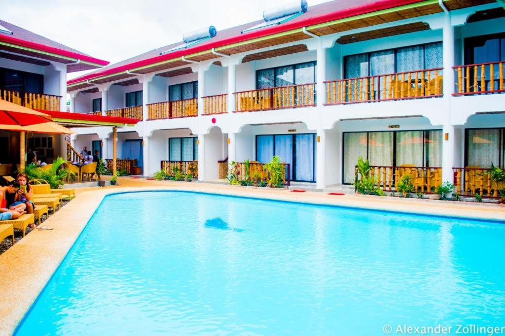 The swimming pool at or close to Alona Vida Beach Hill Resort
