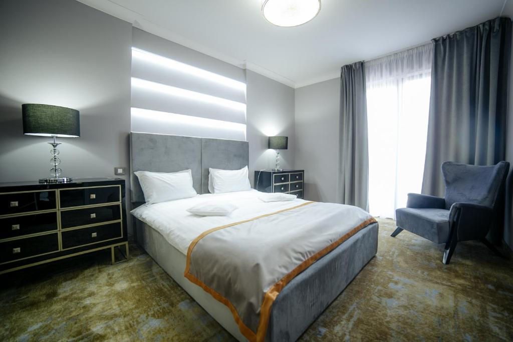 A bed or beds in a room at Royal Classic Hotel