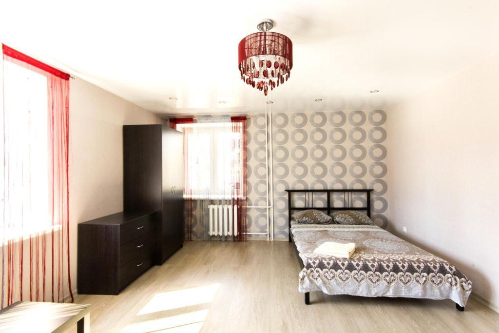 Кровать или кровати в номере Джалиля Киекбаева,4 Однокомнатные апартаменты