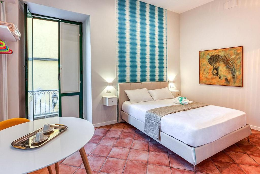 A bed or beds in a room at Localita Renella Apartment Sleeps 6 Air Con WiFi
