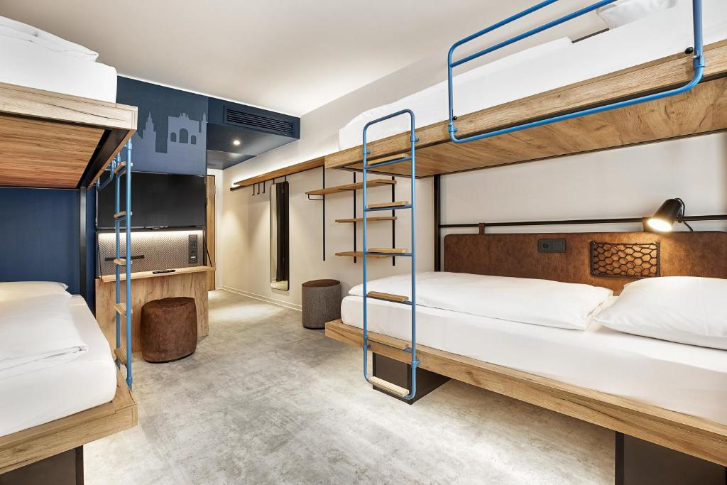 A bunk bed or bunk beds in a room at H2 Hotel München Olympiapark