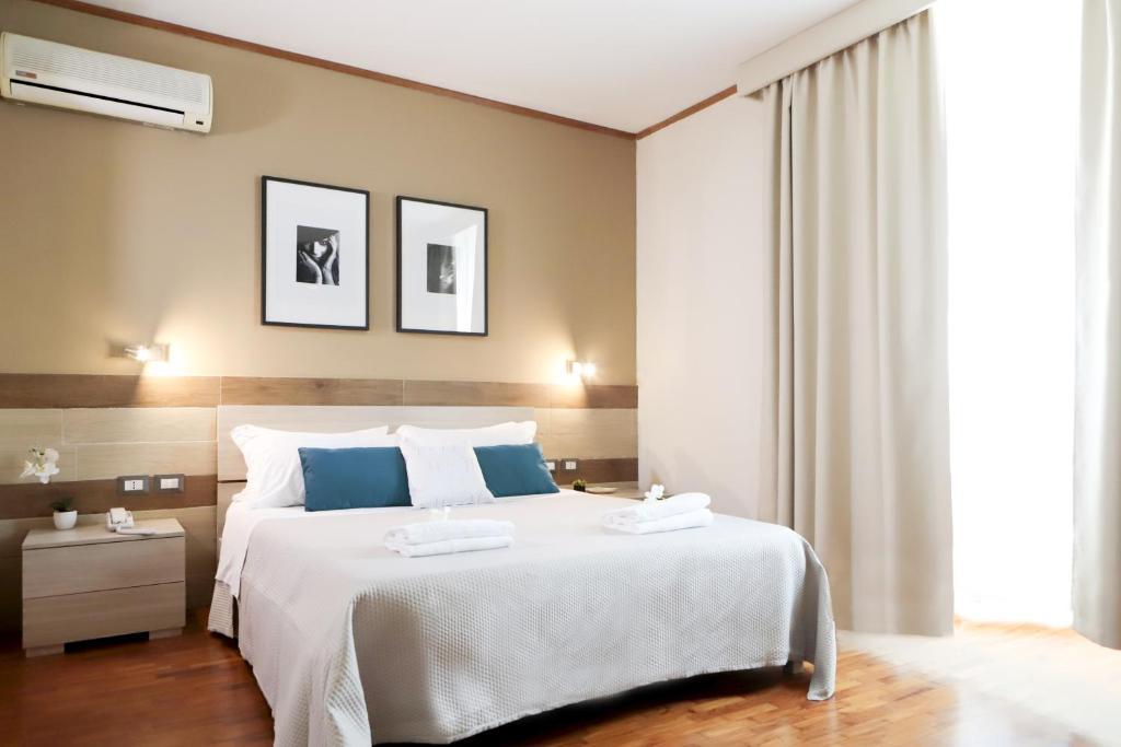Letto o letti in una camera di Pegasus Hotel