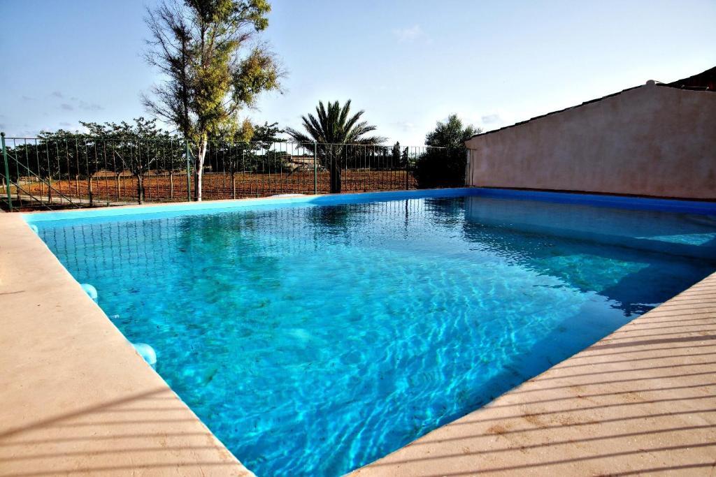 The swimming pool at or near Finca Agroturismo Sa Cova den Borino