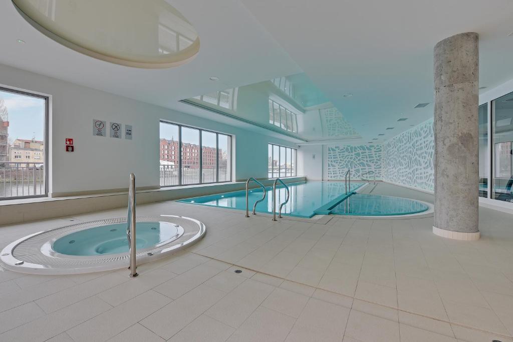 Bazén v ubytování Comfort Apartments Waterlane Island nebo v jeho okolí