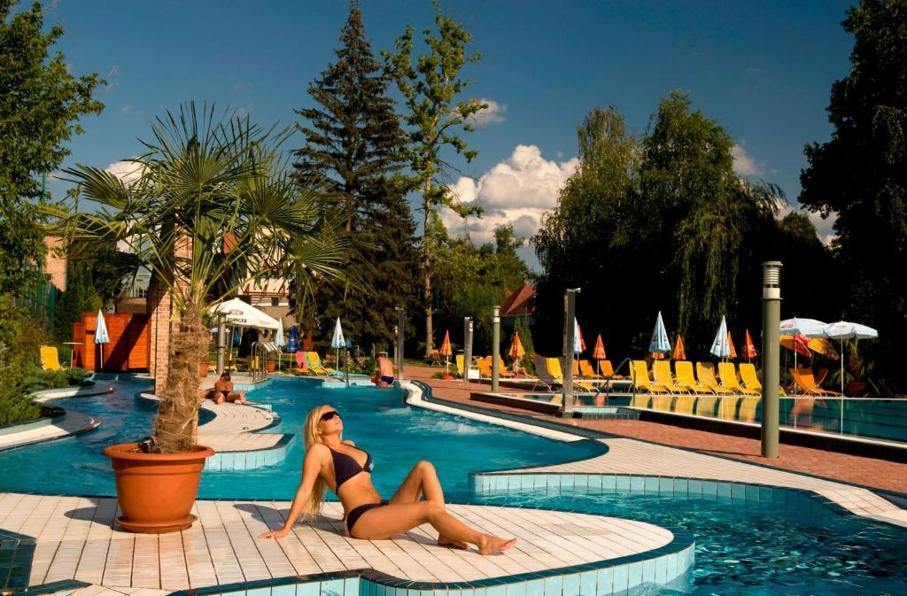 The swimming pool at or near Holiday Beach Budapest Wellness Hotel with Sauna Park