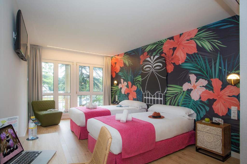 Cama o camas de una habitación en Casual de las Olas San Sebastián