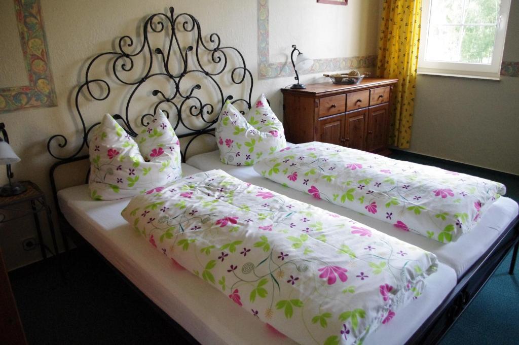 Ein Bett oder Betten in einem Zimmer der Unterkunft La Petite Provence