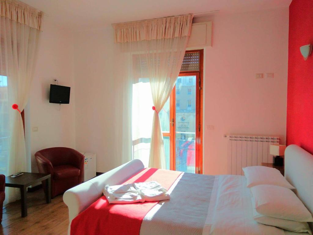 A bed or beds in a room at Leccesalento Bed And Breakfast