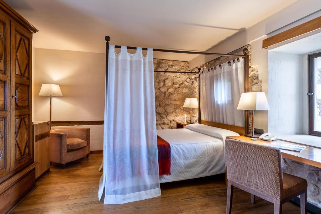 Cama o camas de una habitación en Parador de Alarcón