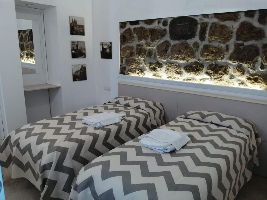 A bed or beds in a room at B&B Ninfa