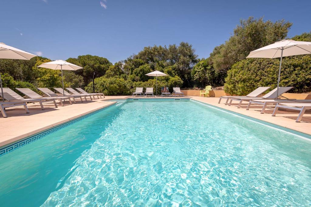 The swimming pool at or near Hotel Cala di l'Oru