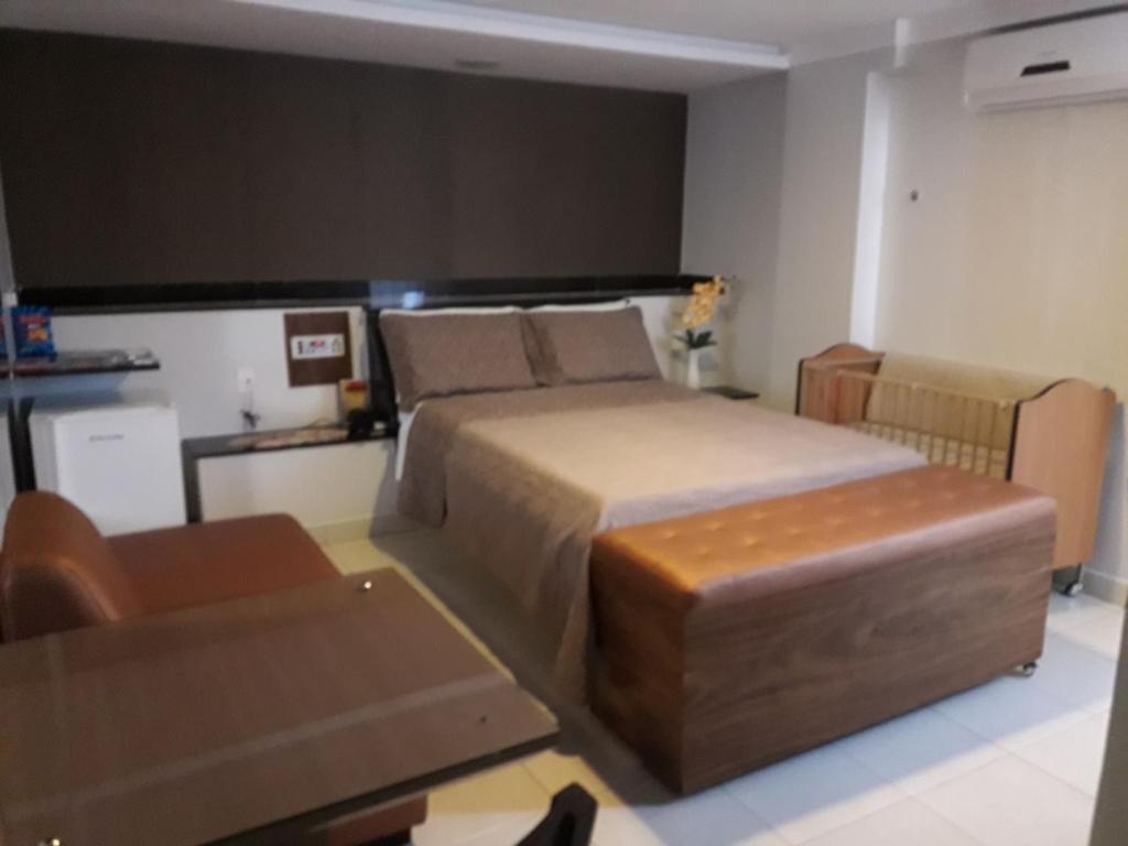 Cama ou camas em um quarto em Hotel Sempre Executive