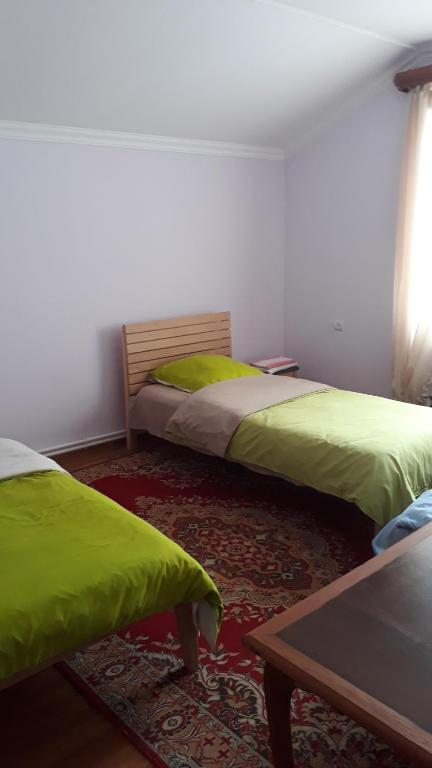 A bed or beds in a room at Green Dilijan B&B