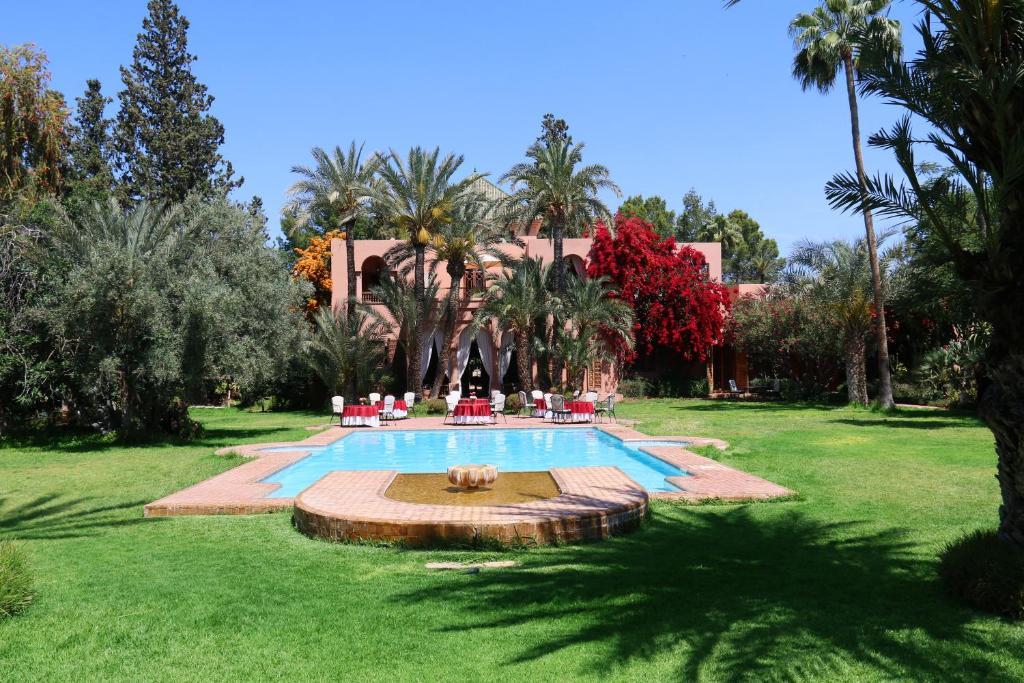 The swimming pool at or near Dar Ayniwen Garden Hotel & Bird Zoo
