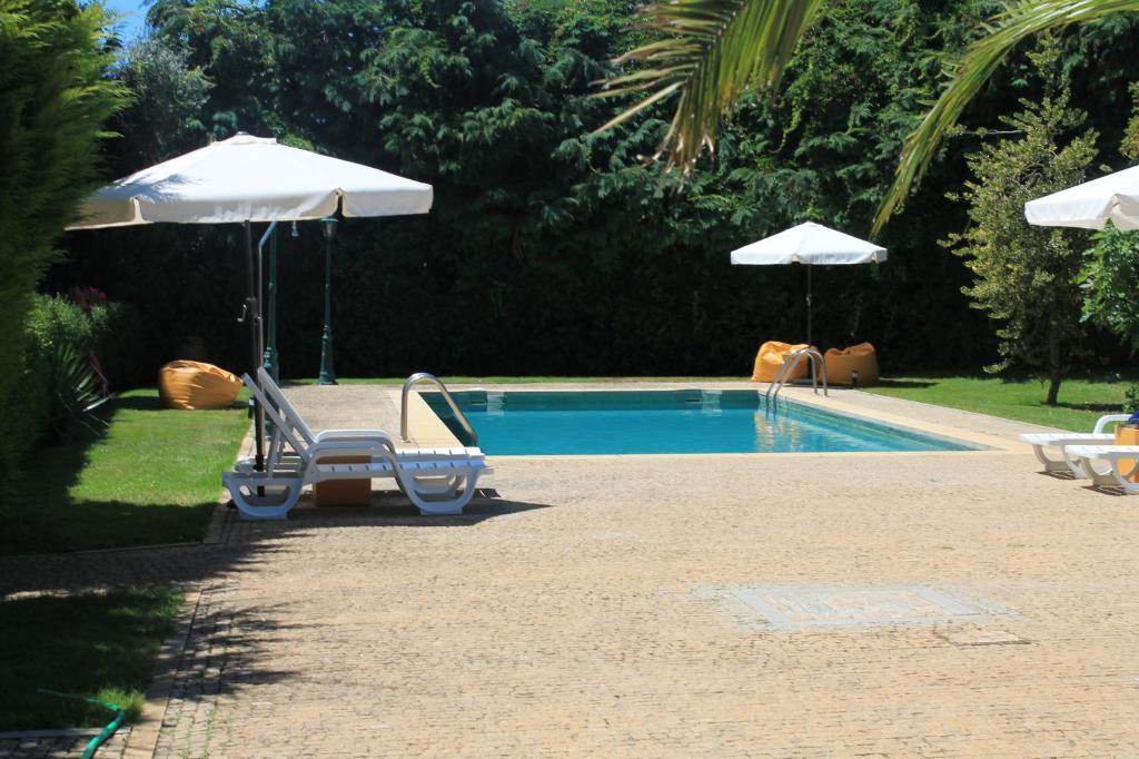The swimming pool at or near Quinta da Boa Ventura
