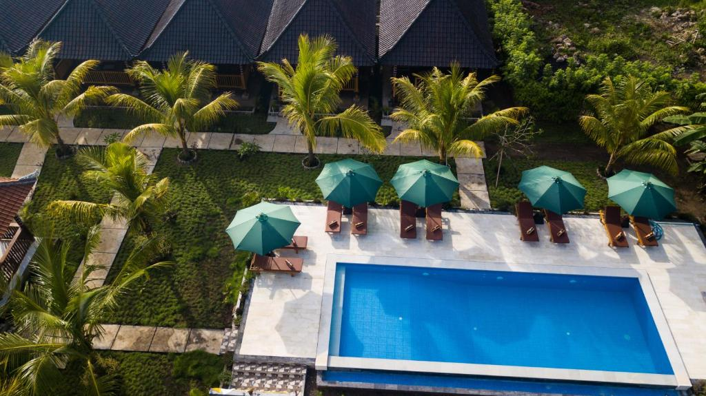 A view of the pool at Ruji Ananta Cottage or nearby