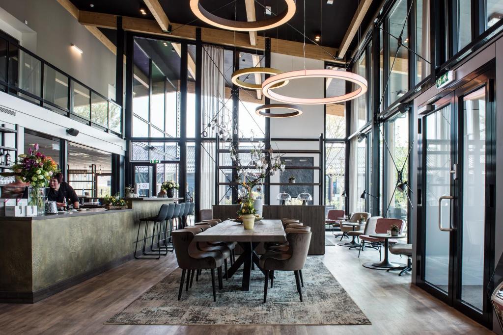 Een restaurant of ander eetgelegenheid bij Fruitpark Hotel & Spa