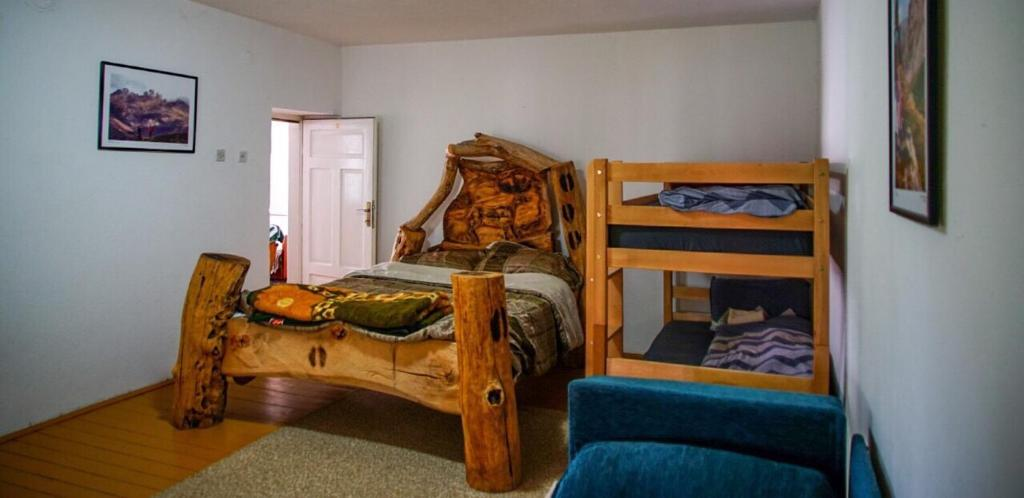 A bunk bed or bunk beds in a room at Kitka Hostel - Vratnica