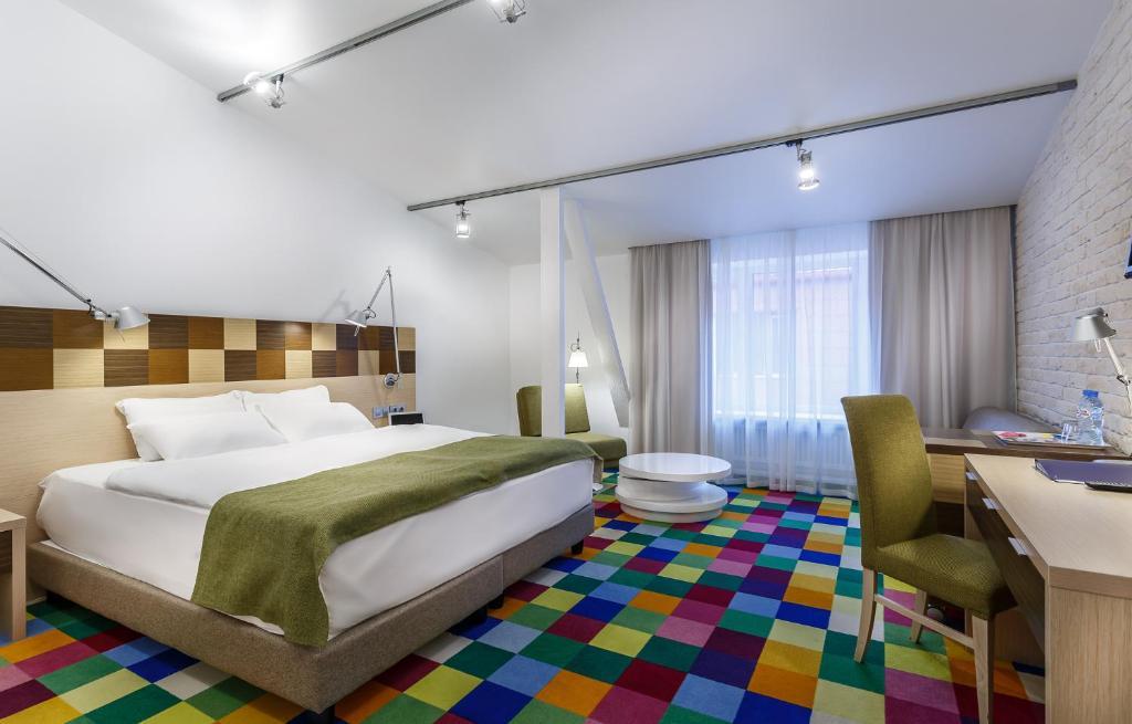 Кровать или кровати в номере Отель Спектр на Таганской