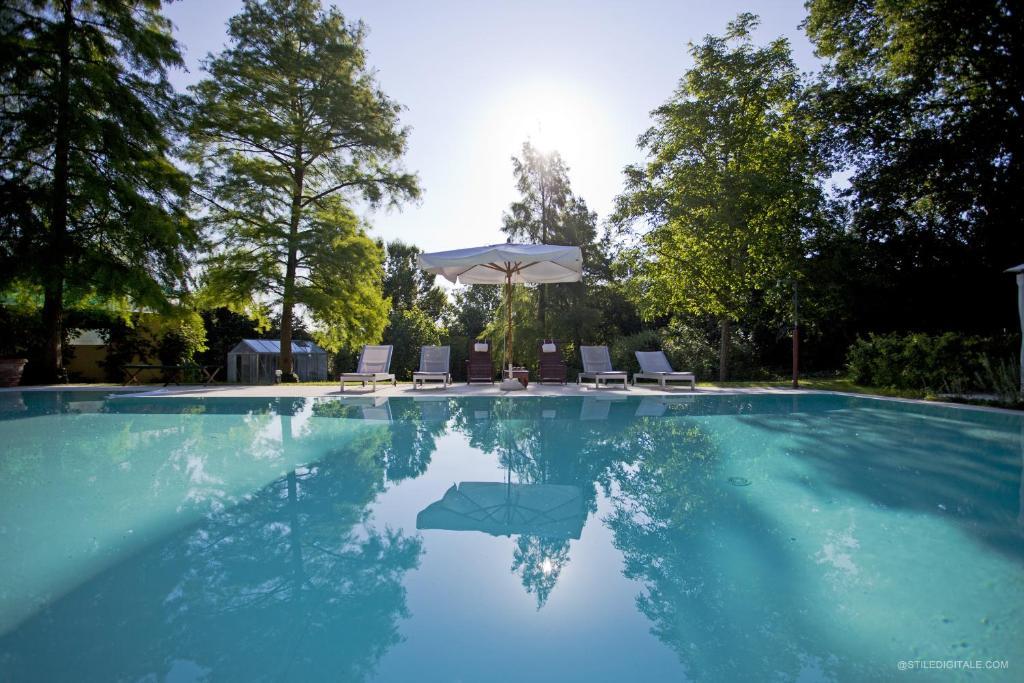 The swimming pool at or near Casino di Pragatto