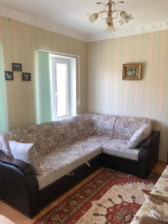 Кровать или кровати в номере Cottage in Kislovodsk 24