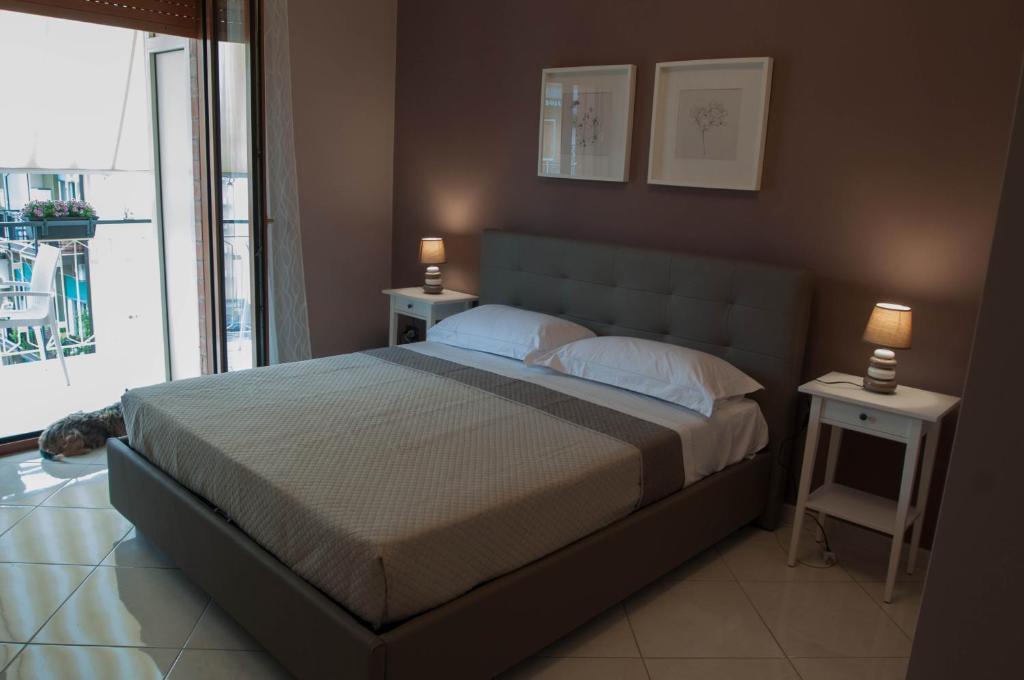A bed or beds in a room at La Fenice
