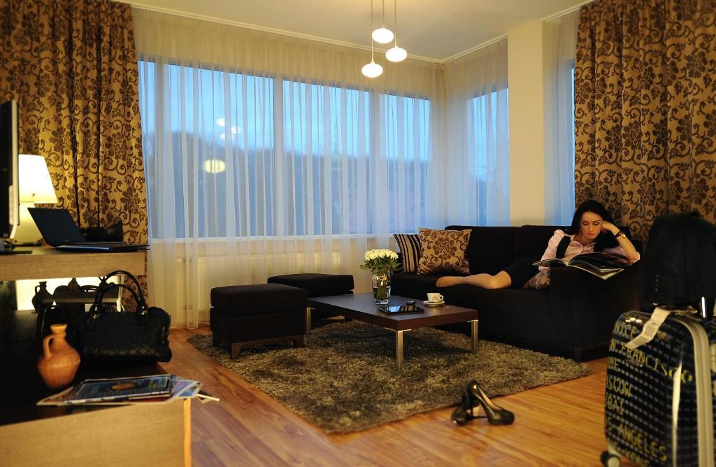 A seating area at Ararat All Suites Hotel Klaipeda
