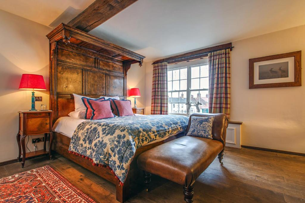 A bed or beds in a room at Byfords