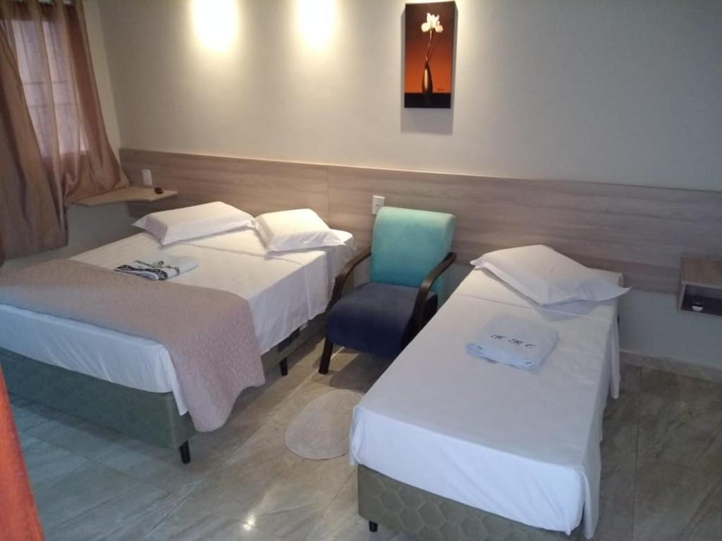 A bed or beds in a room at Hotel Rio Claro