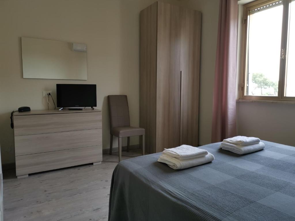 Кровать или кровати в номере Hotel La Pineta
