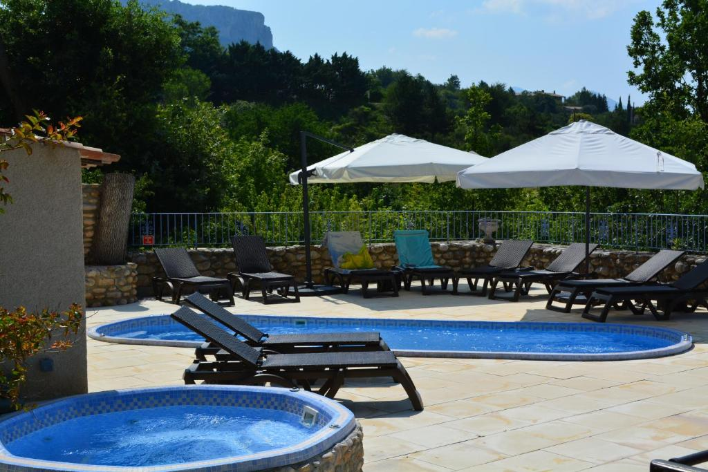 The swimming pool at or near Hôtel Le Colombier